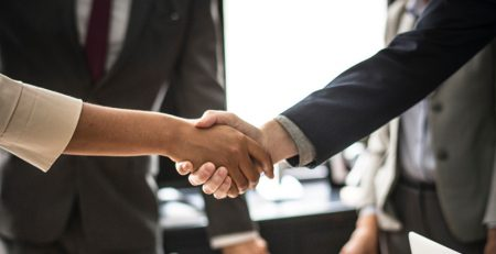 executives shaking hands